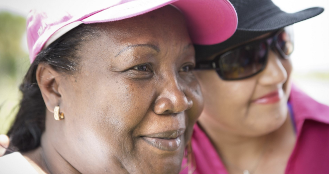 They may have breast cancer. She leads them to screenings and medical care.